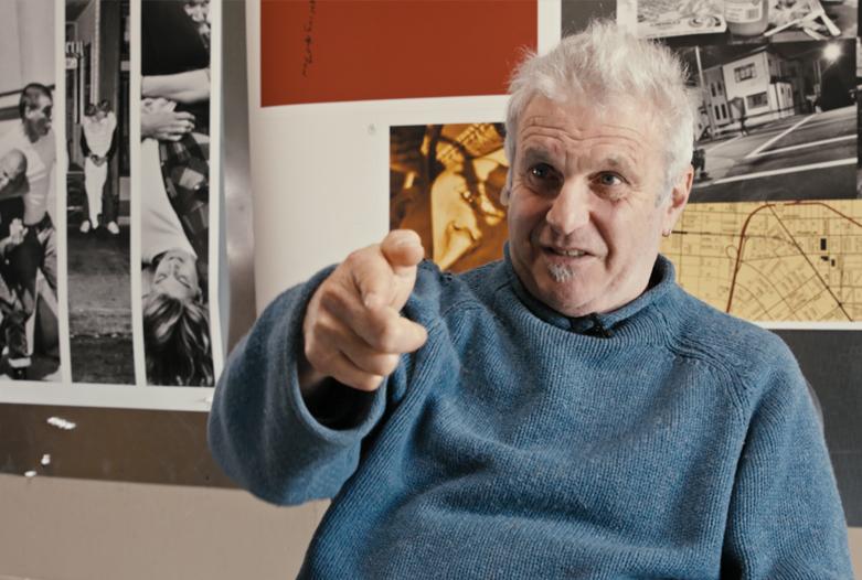 Jim Goldman with Artwork behind him